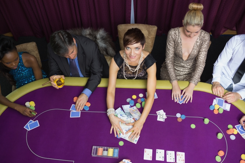 3928253-woman-taking-the-pot-in-poker-tournament